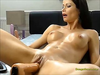 Brunette hottie enjoying her very first time with sex machine and squirting