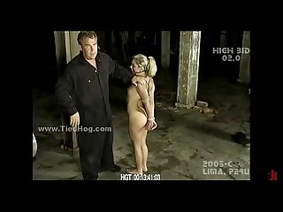 Blonde immobilized in chains bondage