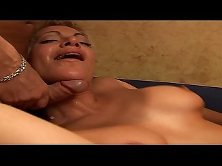 A cute blonde with short hair looks like a whore and fucks with two men