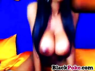 Big breasted black beauty rides her toy on cam