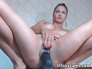 Gorgeous russian MILF huge tits camgirl dildoing on webcam