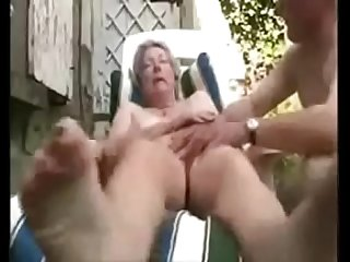 Granny having fun in court yard. Amateur older