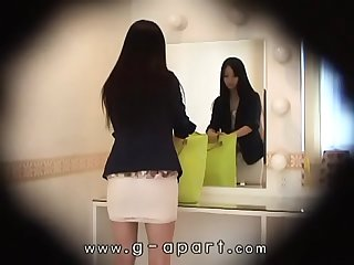 Hiddencam peeping inside the skirt of a slender japanese girl