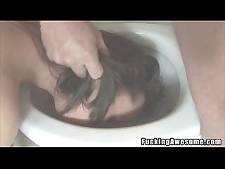Pretty brunette sucks in the toilet