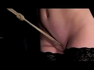 Girl with mouthgag nipple clips rope between legs pussy stimulated with vibrator in the dungeon