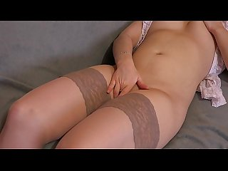 A girl in stockings masturbates her pussy.
