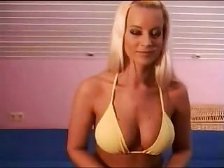 Athletic blonde strips her bikini and plays with her pussy