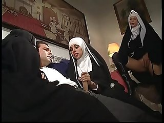 A dirty nun involved in an orgy with a shemale