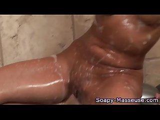 Sexy masseuse babe gives blowjob and soapy massage