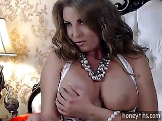 stunning milf with natural big tits, big ass and an amazing tight pussy putting a show on..
