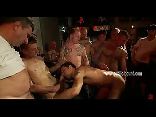 Dirty gay men gather around slave