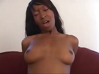 Horny black chick Stacey Cashgets down sucking on long black cock on couch