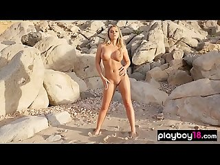 Busty blonde pornstar Tahlia Paris naked on the beach