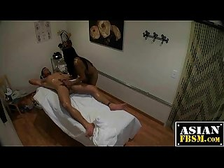 Asian masseuse jerks the cum out of a big one