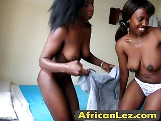 Hot African lesbians play with strapon