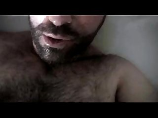 Hairy bear pissing and cumming in his own mouth