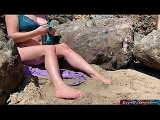 Voluptuous blonde sunbathing nude on the beach fucks passer-by - Erin Electra
