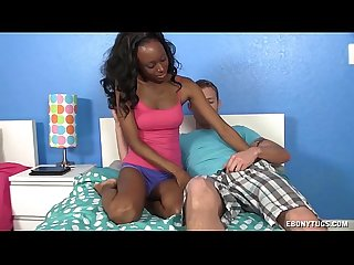 Topless ebony jerks off a big white prick