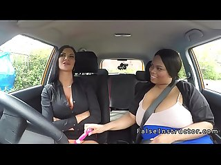 Fat ebony toying in driving school car