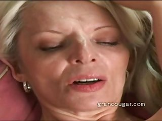 Grancougar milf rubbing her wet pussy after stripping out of her clothes