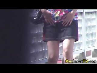 Asian babe gushes urine