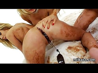 Kinky lesbos fill Up their huge asses with milk and splatter it out