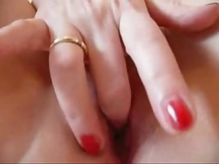 Horny mature milf masturbating her wet shaven pussy