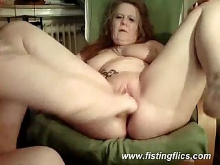 Mature slut fisted in her loose ass and pussy