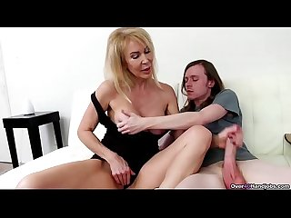 Over40 sexy milf jerks off a huge dick