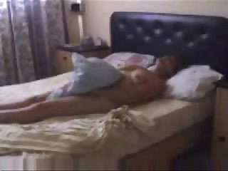 Hidden cam caught my mom masturbating on bed