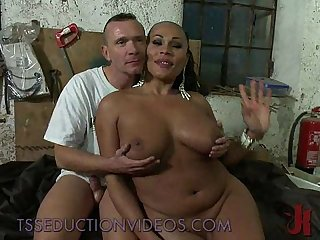 Busty black tranny fucks tied guy in his throat and Ass