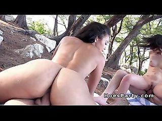 Ebony and white babes sharing cocks on the beach