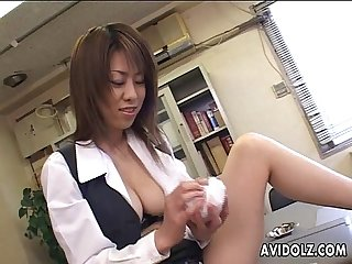Busty japanese cutie wearing fishnet stockings plays with her pussy