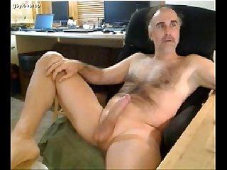 Bear strokes his dick