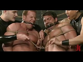 Strong guys suspended in air or tied get fucked in total gay bondage sex