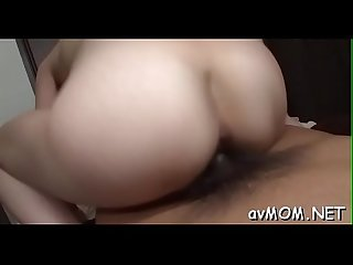 Milf partially shaved muff hugs cock as she rides