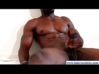 Muscled ebony dude jerks his big dick