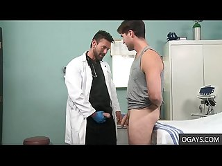 Charming Doctor Alexander Garrett Thoroughly Checks John Carusso's Thick Penis