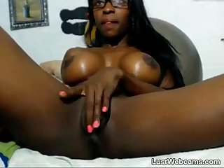 Busty ebony babe rides dildo on webcam