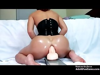 Girl rides a huge dildo and squirts