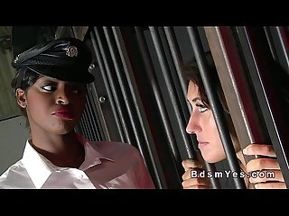Ebony mistress vibrates sexy sub while standing in cage