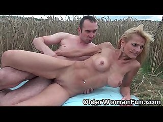 Mommy sucks and fucks outdoors
