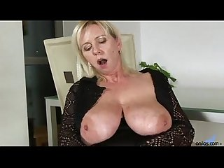Big titted blonde fucks and sucks her dildo