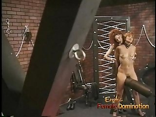 Horny blonde watches as a foxy babe gets pleasured by her domina
