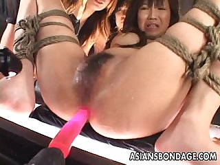 Tied up asian babe gets fucked with a machine