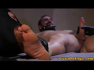 Bdsm hunk edging while masked doms jerk cock