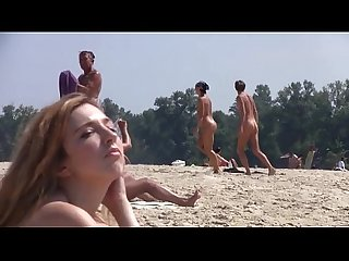 Hot teen blonde plays in the wet sand naked