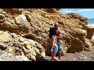 Two spanish sluts taste cock at the beach