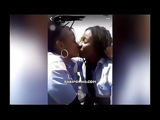 Senegal: 2 student kissing at the school yard, Adji Mbaye, maimouna and penda Hann