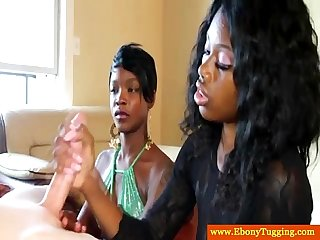 Two ebony handjob babes jerk white dude